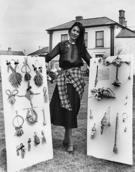 Woman in Cornish traditional costume with Corn Dollies