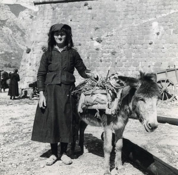 Woman and Donkey. A women and her donkey, Montenegro, 1939 Date: 1939