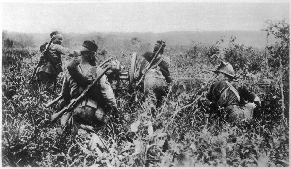 Africans (led by a British Officer) use a light artillery- piece against the Germans at Jabassi