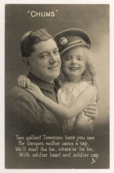 A little girl wears her father's military cap and puts her arms round his neck: two gallant Tommies