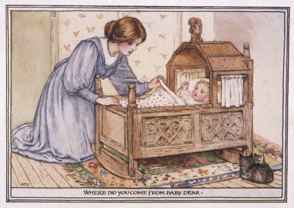 A young mother admires her baby in its cradle
