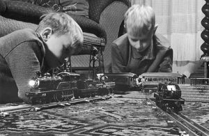 BOYS WITH TRAIN SET