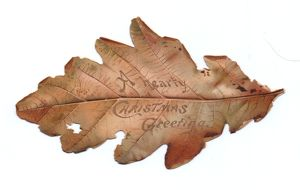 Christmas card in the shape of an autumn leaf