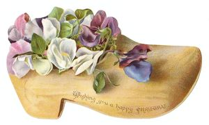 Flowers in a wooden clog-shaped Christmas card
