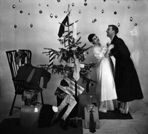 Male and female models in Christmas morning scene