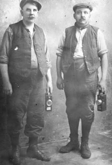 Two middle aged miners with their lamps, South Wales