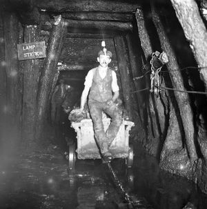 Miner riding drams, Tirpentwys Colliery, South Wales