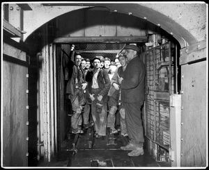 MINERS IN A LIFT SHAFT