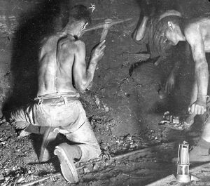 Miners working at the coalface, South Wales