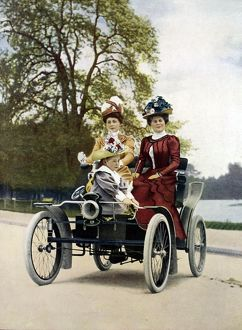 Motoring in the Bois in style in 1900: 'Vis-a Vis' style