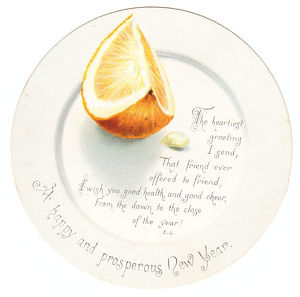 Orange segment on a plate-shaped New Year card