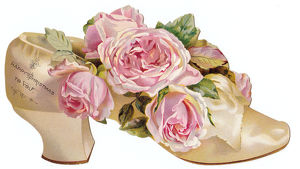 Pink roses in a shoe-shaped Christmas card