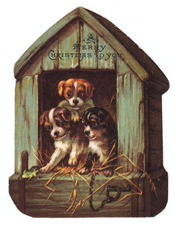 Three puppies on a kennel-shaped Christmas card