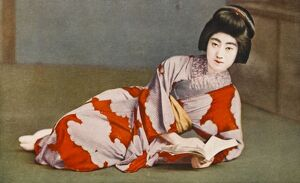 Reclining Japanese girl reading