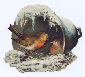 Robins nesting on a bell-shaped Christmas card