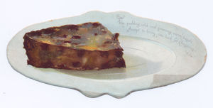 Slice of pudding on a plate on a shaped Christmas card