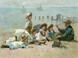 Storytelling to children on the beach during the summer