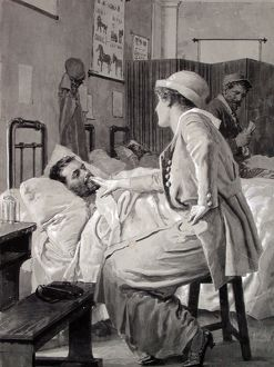 Wounded French soldier lying in bed in a hospital ward